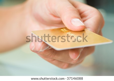 Macro image of plastic card in human hand - stock photo