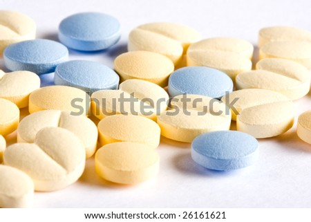Macro image of round and heart-shaped little pills