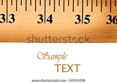 Macro image of wooden yardstick on white background with copy space. #54995008