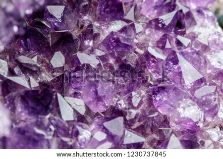 Macro Mineral Stone Amethysts in the rock on a white background close up #1230737845