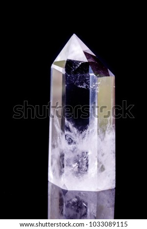 Macro mineral stone Crystal rock crystal on a black background close-up #1033089115