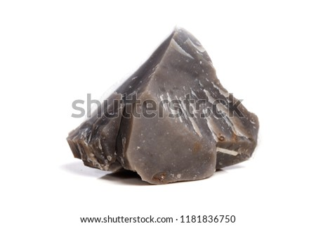 Macro mineral stone Flint in the rock on a white background close up