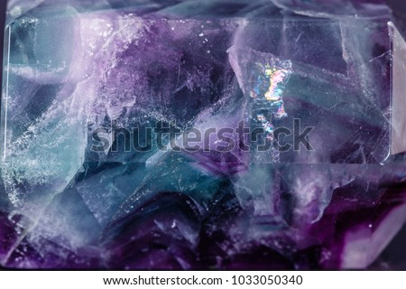 Macro mineral stone Fluorite crystal on a black background close-up #1033050340