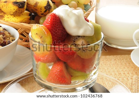 Macro of a bowl of strawberries and kiwis