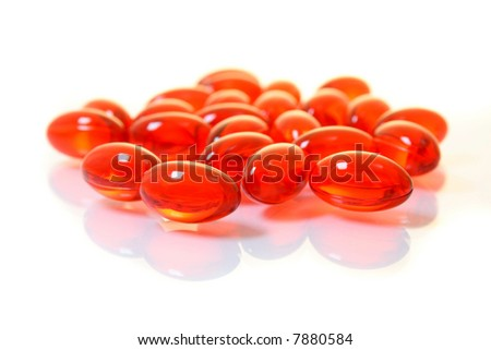Macro of a bunch of red gel pills.