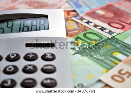 macro of a calculator over many euro banknotes - stock photo
