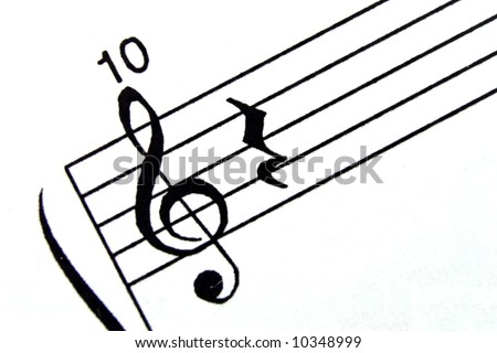 macro of a clef on a  music score