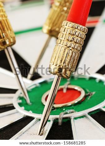 Macro of a Dart in a Dartboard