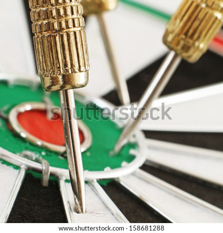 Macro of a Dart in a Dartboard