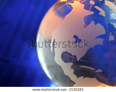 macro of a glass globe in front of business figures, with focus on north and central america - stock photo