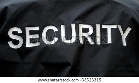 macro of a jacket of a security guard - stock photo