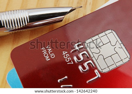 Macro of a Red Credit Card with a Pen