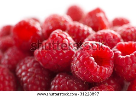 Macro of a stack of raspberries against white background (shallow DOF)