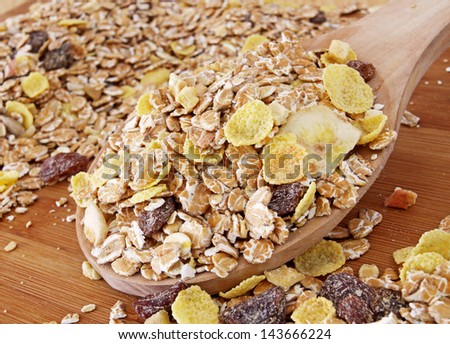 Macro of a Wooden Spoon full of Healthy Muesli