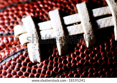 macro of american football stitching