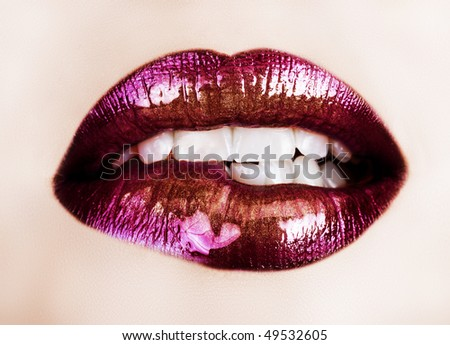 macro of beautiful lips with purple and gold lipstick