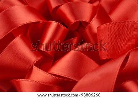 Macro of 	beautiful red satin ribbon background