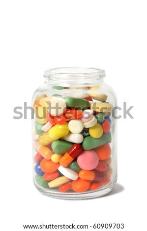 Macro of capsules and pills on white background