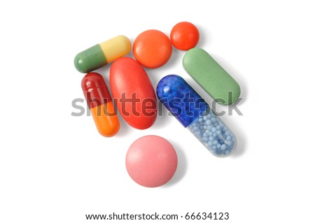 Macro of capsules and pills on white background - stock photo
