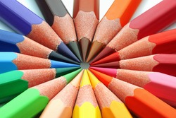 Macro of colored pencils in a circle.