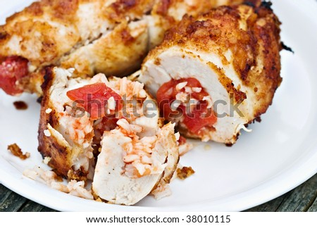 Macro of crusty rolled chicken stuffed with spanish rice.