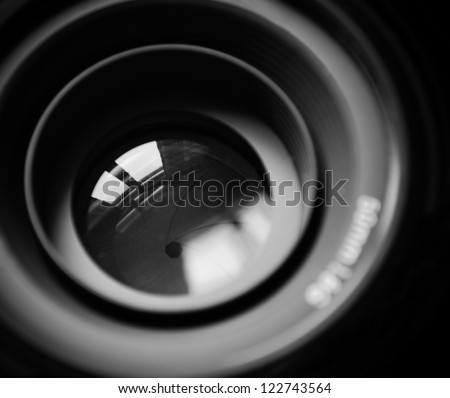 Macro of DSLR lens in b/w - stock photo