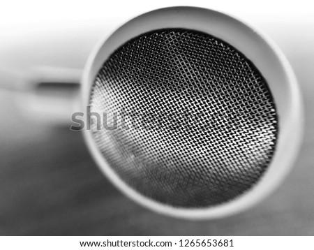 Macro of earphone. Earphone with round plastic shape in monochrome.