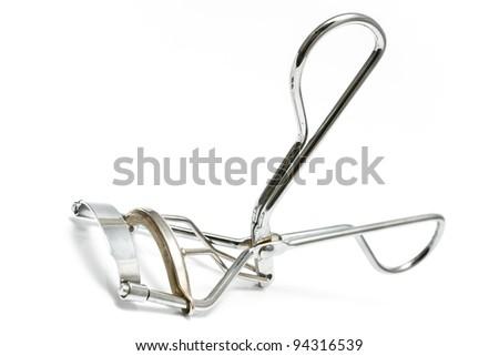 Macro of eyelash curler isolated on white