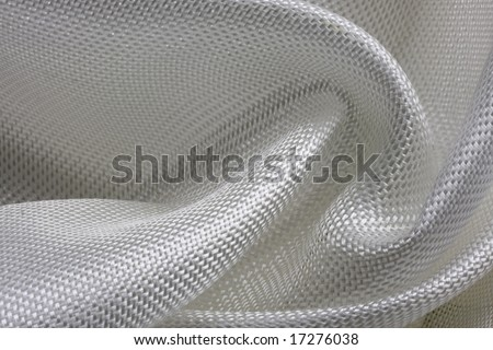 macro of fiberglass cloth composed into a swirl pattern