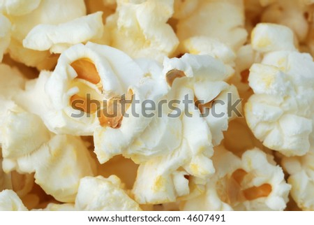 macro of freshly popped, buttered popcorn