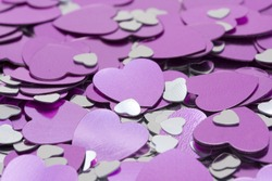 macro of metalic pink and silver hearts