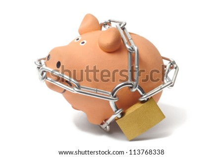 Macro of piggy bank with padlock and chains