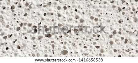 Macro of pumice stone. Grey porosity Stone, rough pumice texture background. High resolution photo. Full depth of field. Stockfoto ©