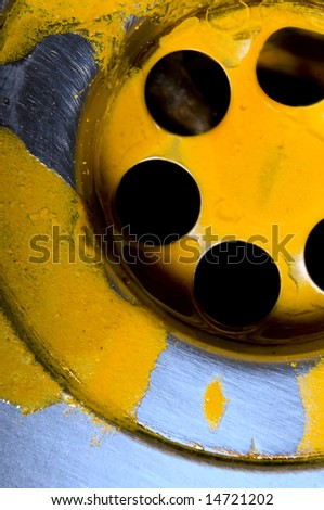 Macro of sink with yellow liquid substance