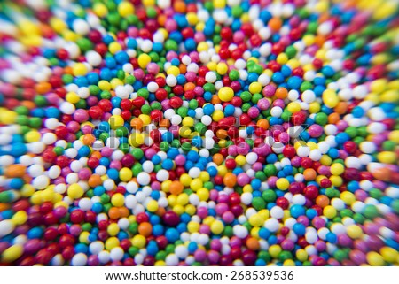 Macro of Sugar colorful balls powder background