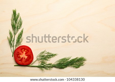 Macro of tomato and dill on wood background