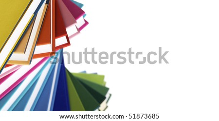 Macro of twisted stack of colorful real books on white background.