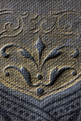 Macro of vintage book cover with flower ornament. Wisdom, education or book repair concept.