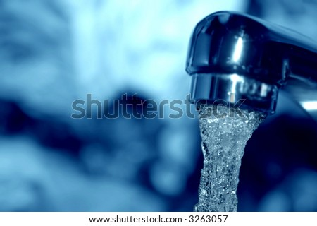 Macro of water flowing from a tap - shallow DOF