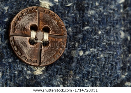 macro or close-up photo of the vintage shirt button. the focus on the button. this is textile, texture, or tissue concepts. It could be also background, wallpaper, abstract concept. Stock fotó ©