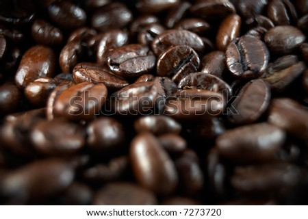 Macro or closeup of coffee beans with a very narrow depth of field - stock photo