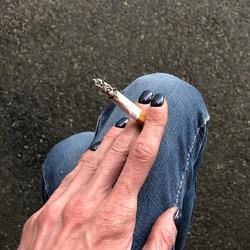 Macro photo cigarette smoking. Stock photo cigarette in the hand. woman smokes a cigarette