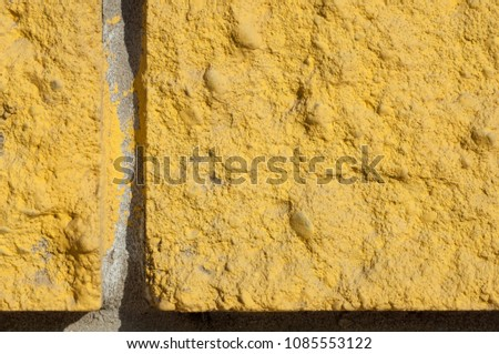 Macro photo. Close-up. Decorative bricks decorative yellow #1085553122