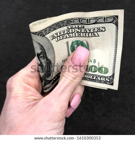 Macro photo dollar bill in hand 100 dollars bill in hand