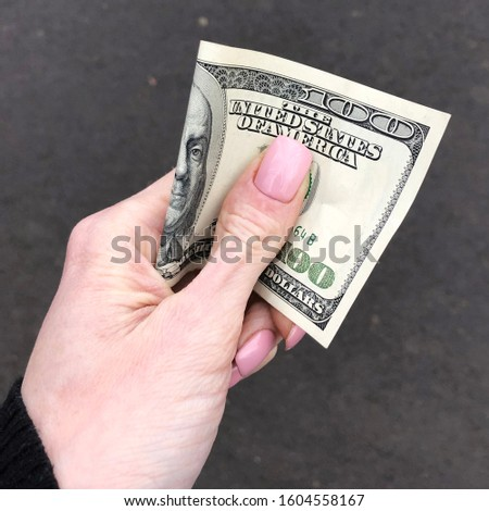 Macro photo dollar bill in hand.Stock photo 100 dollars bill in hand