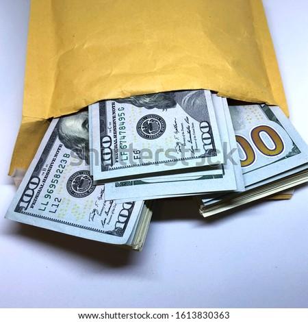Macro photo dollar bills in yellow envelope. Stock photo dollars bill in pocket