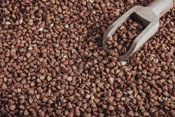 Macro Photo food buckwheat groats. Texture background grain buckwheat groats. Image food product porridge buckwheat grains.