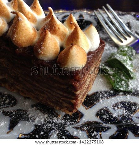 Macro photo food dessert cake with cream. Texture background sweetness piece of chocolate cake with cream and fork on a plate. Image of a sponge cake dessert with chocolate