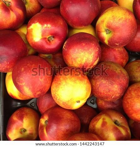 Macro Photo food tropical fruit nectarine. Texture background sweet red ripe nectarine. Image food fruit nectarine