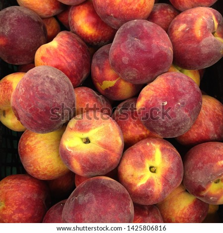 Macro Photo food tropical fruit peach. Texture background of sweet red ripe peaches. Image food fruit peaches